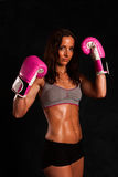 Portrait of pretty young woman doing boxing exercise Stock Photos