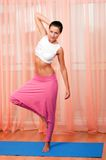 Portrait of pretty young woman doing yoga exercise Stock Photos
