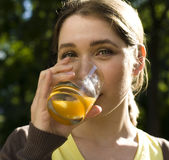 Portrait of pretty young woman drinking juice, healthy lifestyle Stock Photos