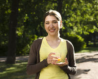 Portrait of pretty young woman drinking juice, healthy lifestyle Stock Images