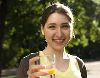Portrait of pretty young woman drinking juice, healthy lifestyle Royalty Free Stock Image