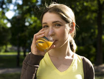 Portrait of pretty young woman drinking juice, healthy lifestyle Stock Photo