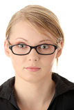 Portrait of a pretty young woman in glasses royalty free stock photography
