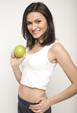 Portrait of pretty young woman with green apple Royalty Free Stock Photo