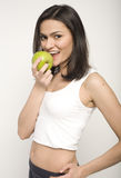 Portrait of pretty young woman with green apple Royalty Free Stock Photography