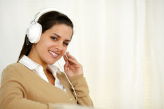 Pretty young woman with headphone listening music Stock Photos