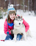 Portrait of a pretty young woman with her pet dog Stock Photography