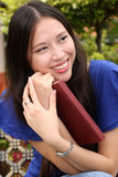 Portrait pretty young woman holding a book. With smile Stock Images