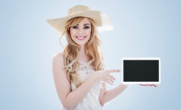 Portrait of a pretty young woman holding an electronic device Royalty Free Stock Images