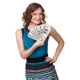 Portrait of pretty young woman holding a fan of dollar bills Royalty Free Stock Photo