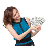 Portrait of pretty young woman holding a fan of dollar bills Stock Photography