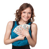 Portrait of pretty young woman holding a fan of dollar bills Stock Image
