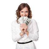Portrait of pretty young woman holding a fan of dollar bills Royalty Free Stock Photos