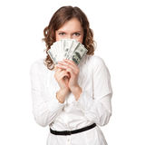 Portrait of pretty young woman holding a fan of dollar bills Royalty Free Stock Images
