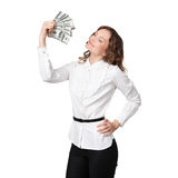 Portrait of pretty young woman holding a fan of dollar bills Stock Photo
