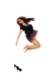 Portrait of a pretty young woman jumping in joy Stock Photography