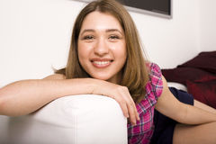 Portrait of pretty young woman laying on sofa Royalty Free Stock Photo