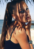 Portrait of pretty young woman with long hair posing on beach Royalty Free Stock Image