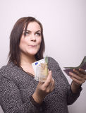 Portrait of pretty young woman with money Stock Photos
