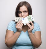 Portrait of pretty young woman with money Stock Image