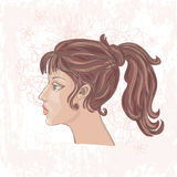 Portrait of pretty young woman in profile Stock Photography