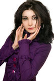Portrait of pretty young woman in a purple jacket. Isolated Stock Image