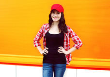 Portrait of pretty young woman in red cap and checkered shirt Stock Photo