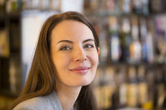 Portrait of pretty young woman in restaurant, look Royalty Free Stock Photography
