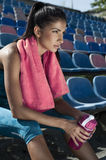 Portrait of a pretty young woman resting after workout. Woman after workout at the stadium Royalty Free Stock Photography