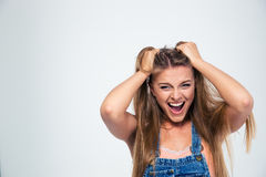 Portrait of a pretty young woman shouting Royalty Free Stock Photos