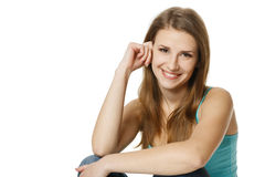 Portrait of a pretty young woman sitting Stock Photography