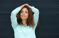 Portrait of a pretty young woman smiling with hands in hair Stock Image