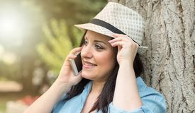 Portrait of pretty young woman talking on mobile phone, light effect Stock Photography