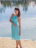 Portrait of a pretty young woman wearing a blue dress. Royalty Free Stock Photography
