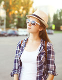 Portrait of pretty young woman wearing a sunglasses and hat Stock Photos
