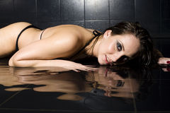 Portrait of pretty young woman with wet hair and lingerie Stock Images