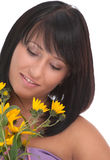 Portrait of a pretty young woman with yellow flowe Stock Photo