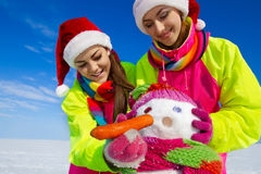 Portrait of a pretty young women with a snowman Stock Image