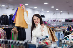 Portrait of prety woman with shopping bags. At fashionable store Royalty Free Stock Photos