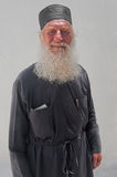 The portrait of a priest of Church of Assumption of the Virgin Mary in Naoussa,  Paros, Greece 2 Stock Photos