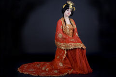 Portrait of a princess. Portrait of an elegant asian princess dressed in golden and red with a crown Stock Image
