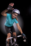 Portrait of professional bike athlete waving hand. Portrait of woman riding bike over isolated background. model equipped with a professional biking gear, uses stock photography
