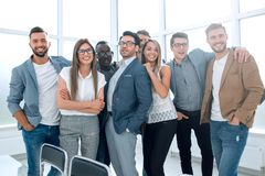 Portrait of a professional business team standing in a modern office royalty free stock photography
