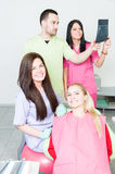 Portrait of a professional dentist team. Analyzing an xray stock photography