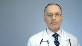 Portrait of professional doctor posing for camera, quality clinic services. Stock photo Royalty Free Stock Photos