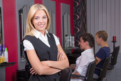 Portrait of professional hairdresser posing in beauty salon Stock Photos