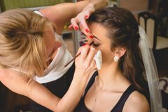 Portrait of professional makeup artist applying mascara Royalty Free Stock Image