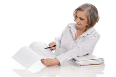 Portrait of professional older businesswoman presenting a paper. Stock Photos