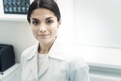 Portrait of a professional skillful doctor. Experienced neurologist. Portrait of a professional skillful female doctor smiling and looking at you while working Stock Photo