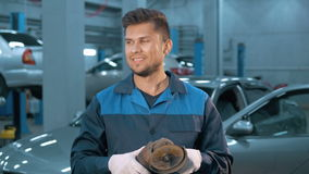 Portrait of Professional smiling car mechanic working in modern auto repair service stock video